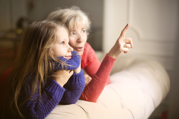 grandmother and granddaughter connecting